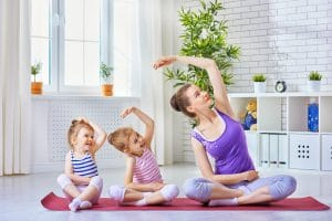 mom and daughters yoga