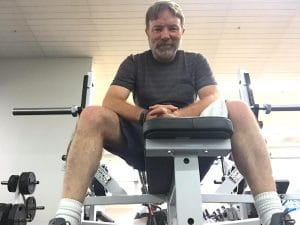 older man on exercise equipment