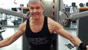 older man lifting in gym