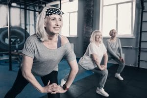 older women doing lunges