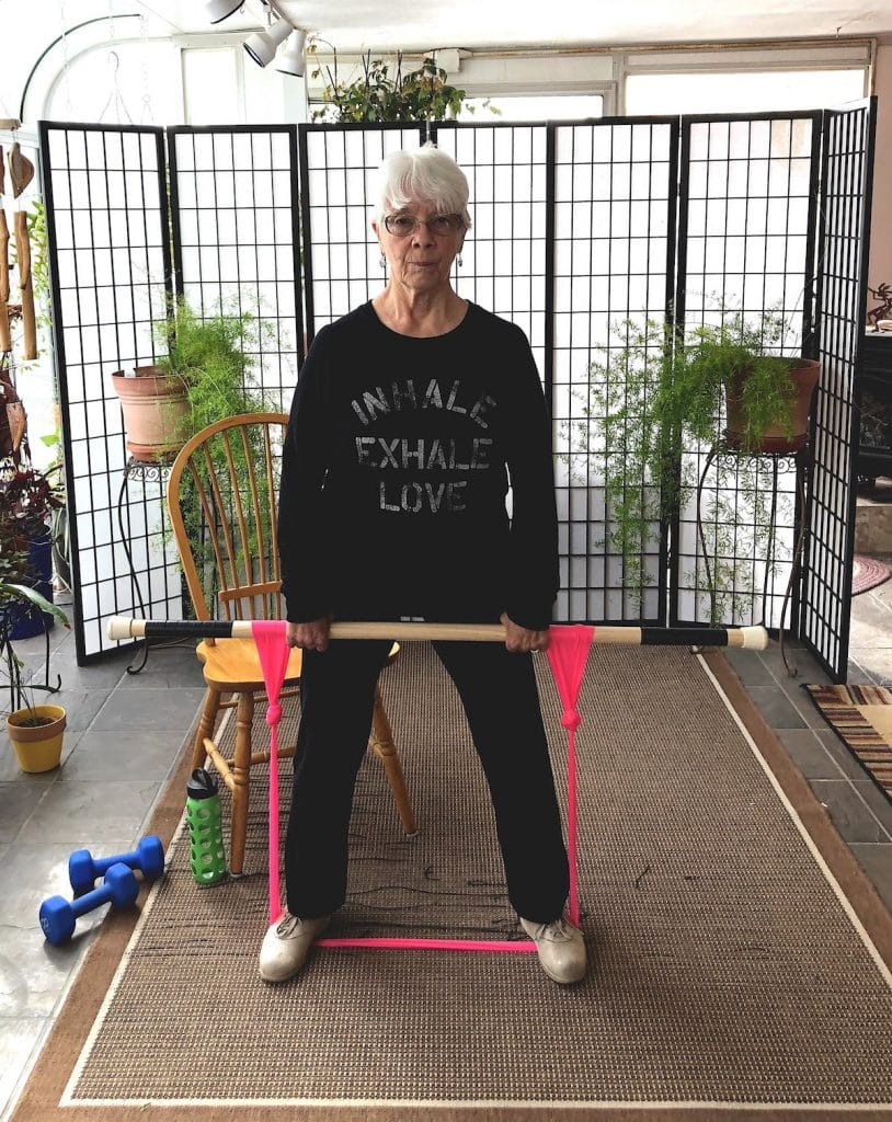 older woman working out at home