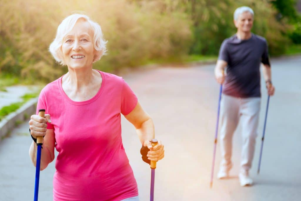 older woman nordic walking