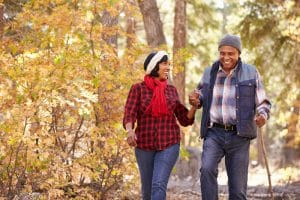 couple walking in autumn woods