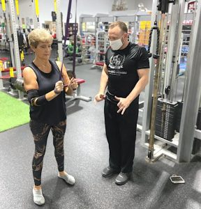 older woman strength training in gym