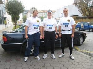 older men wearing race bibs before running race